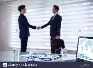 business partnership contract business agreement in office handshake business agreement partnership gmgc